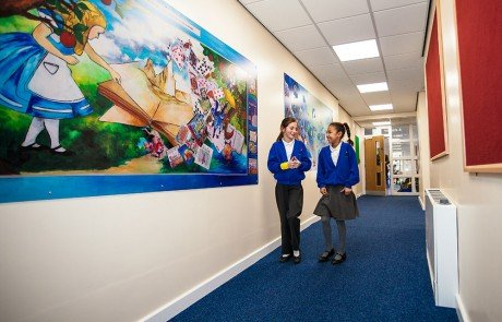 Ryecroft Academy students walking past a reading circles corridor display
